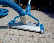 Picture of a pool Vacuum on the tile deck beside a swimming pool in Little Rock AR