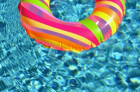 Picture of a colorful swim ring floating on shimmering pool water in Little Rock Arkansas